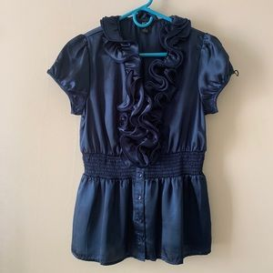 Navy with sheen BCX blouse with neck ruffles.
